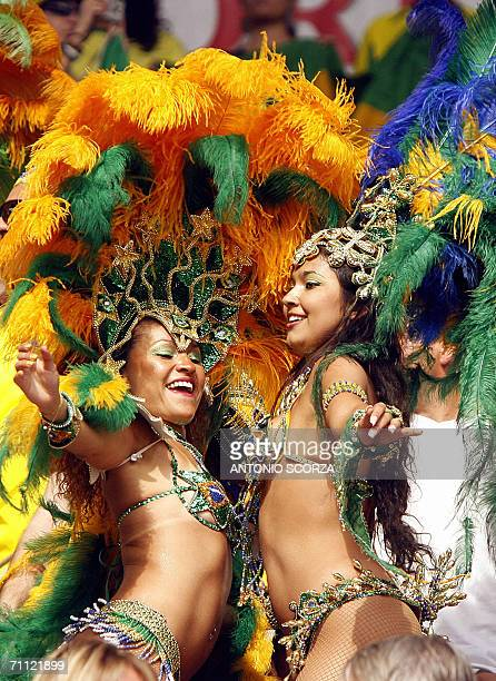 Brazilian samba dancers performs cheering their team, 04 June 2006, during a friendly match against New Zealand at the Stade de Geneve, in...