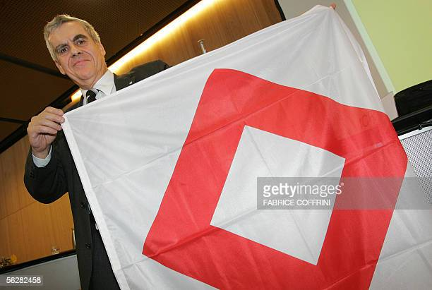 International Red Cross Comittee cooperation director Francois Bugnon pose with the red crystal emblem after a press conference 28 November 2005 in...