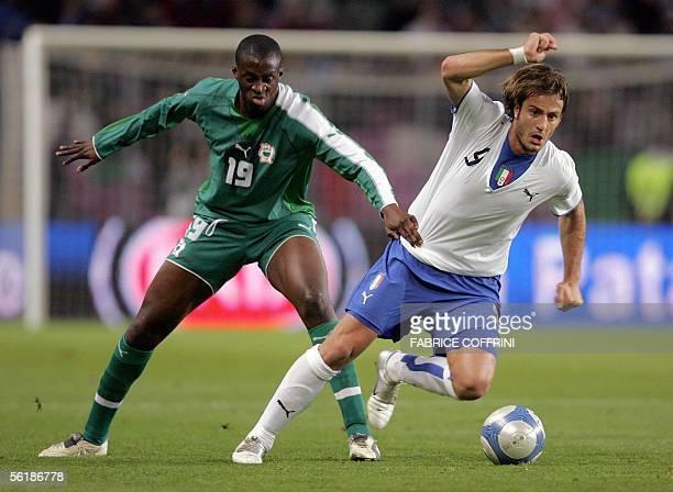 Italia's Alberto Gilardino vies with Ivory Coast's Yaya Toure, during a friendly football match Italy vs Ivory Coast, preparation to the World Cup...