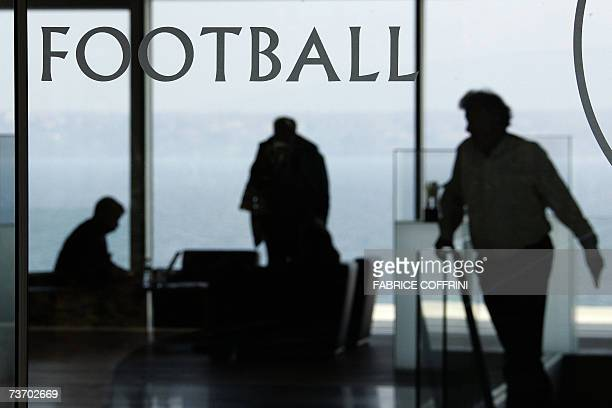 Silhouettes are seen inside the UEFA Headquarters on 26 March 2007 in Nyon UEFA said on Monday that it was ready to give clubs players and national...