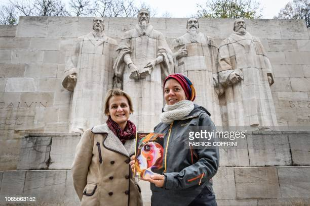 Geneva theology professors Elisabeth Parmentier and Lauriane Savoy pose under the reformation wall with a edition of A Women's Bible on November 20...