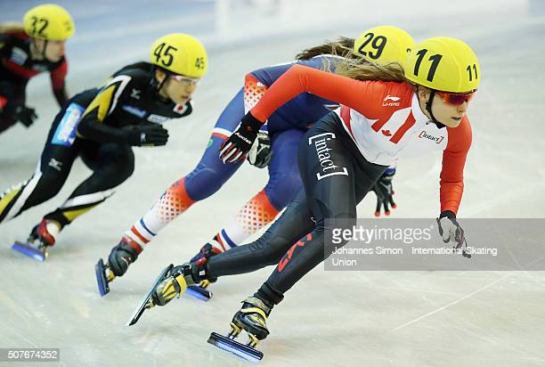 Geneve Belanger of Canada Aurelie Monvoisin and of France Aoi Watanabe of Japan and Gina Jacobs of Germany compete in the 500m ladies heats during...