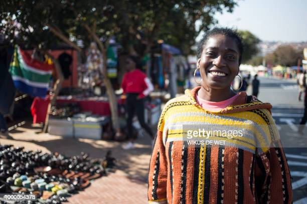 Genevieve Assamoi an European Special Agency worker speaks about the legacy of antiapartheid icon Nelson Mandela in Soweto on July 11 2018 A black...