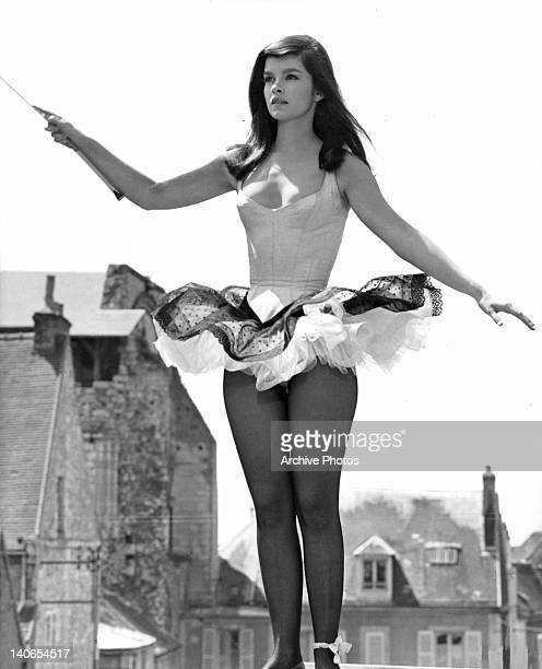 Genevieve Bujold outside waving wand in a scene from the film 'The King Of Hearts' 1966