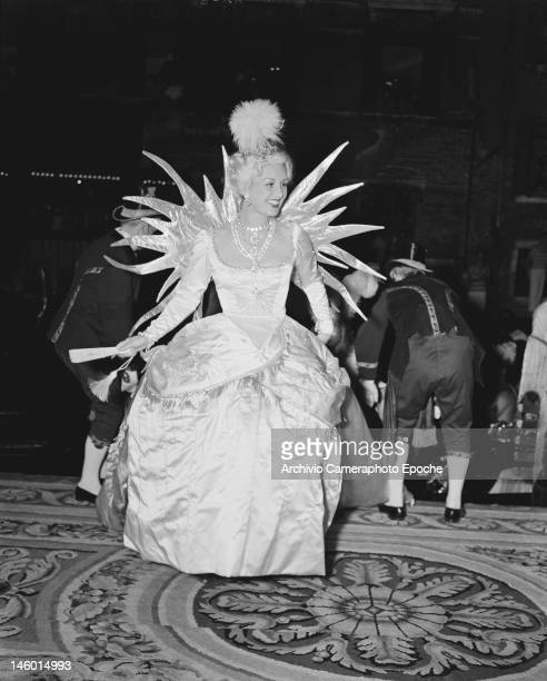 Genevieve Fath as the Queen of the Night at a masked costume ball at the Palazzo Labia Venice 3rd September 1951 She is the wife of French fashion...