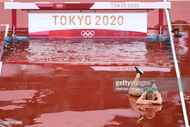 Genevieve Gregson of Team Australia lays injured during the Women's 3000m Steeplechase Final on day twelve of the Tokyo 2020 Olympic Games at Olympic...