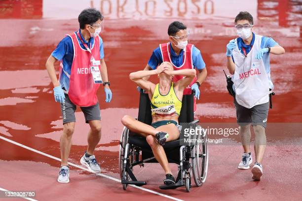Genevieve Gregson of Team Australia reacts as she is wheeled off injured during the Women's 3000m Steeplechase Final on day twelve of the Tokyo 2020...