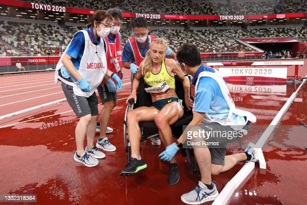 Genevieve Gregson of Team Australia receives medical attention during the Women's 3000m Steeplechase Final on day twelve of the Tokyo 2020 Olympic...