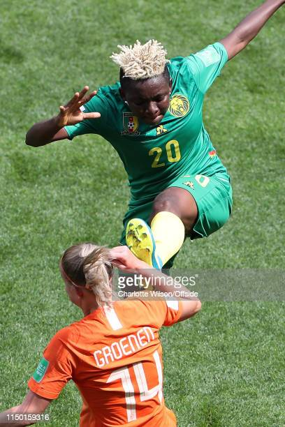 Genevieve Ngo Mbeleck of Cameroon connects with the arm of Jackie Groenen of the Netherlands as she clears the ball during the 2019 FIFA Women's...