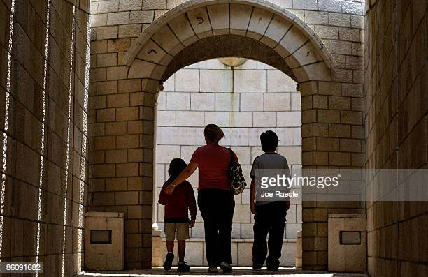 Genevieve Pared walks with her son's Jason Pared and Jacob Pared as they visit the Holocaust Memorial during Yom HaShoahHolocaust Remembrance Day on...