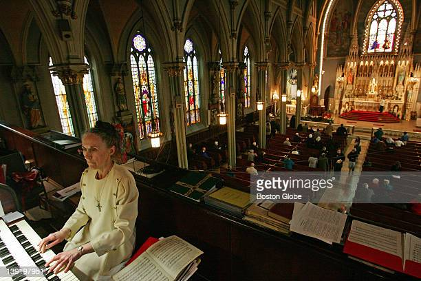 Genevieve Schmidt director of music and organist at the Holy Trinity Church during a Latin Mass on Easter Sunday April 8 2007 Next Sunday will be the...