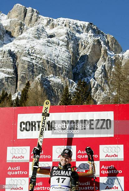 Genevieve Simard of Canada celebrates on podium after winning the women's SuperG World Cup race in Cortina D'Ampezzo 14 January 2004 Maria Riesch of...