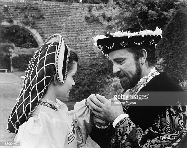 Geneviève Bujold has her hand held by Richard Burton in a scene from the film 'Anne Of The Thousand Days' 1969