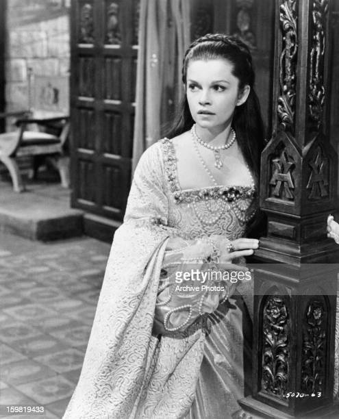 Geneviève Bujold leaning against column in a scene from the film 'Anne Of The Thousand Days' 1969
