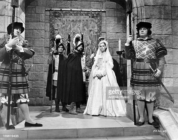 Geneviève Bujold makes her entrance to a party at court in a scene from the film 'Anne Of The Thousand Days' 1969
