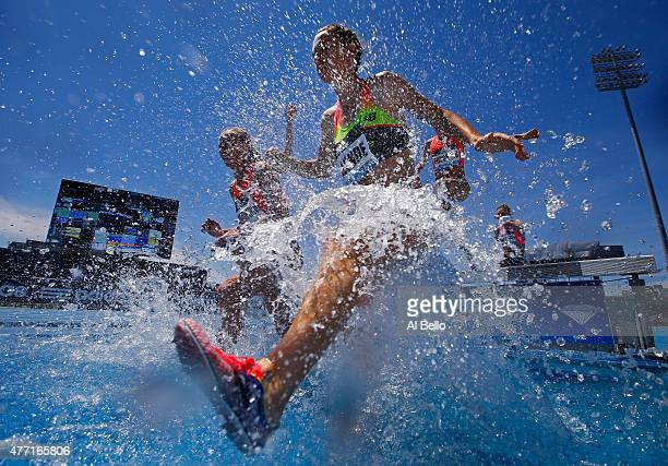 Geneviève Lalonde of Canada leaps over the water jump during the Women's 3000m Steeplechase during the Adidas Grand Prix at Icahn Stadium on...