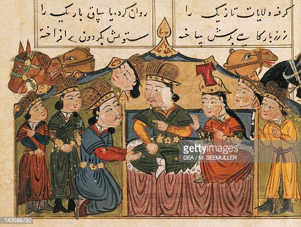 Genghis Khan seated on his throne with his wife under a tent with four Mongols and camels miniature from Mongolian History in Verse Persia 15th...