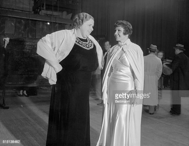 Genial Kate Smith of radio fame and Claudette Colbert seen at the Christmas benefit show staged by a Los Angeles newspaper at the Shrine Civic...