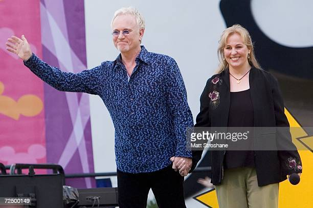 Genie Francis who played Laura Spencer and Anthony Geary who played Luke Spencer wave to onlookers after a Q and A at Walt Disney World's MGM Studios...