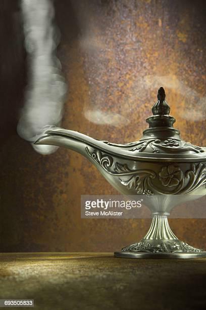 Genie Lamp on rust background