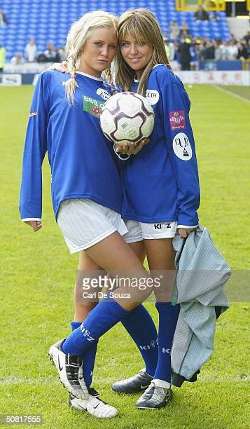 Genie Queen's Anna Ord and Abbey Clancy pose at annual 'Music Industry Soccer Six' fundraising tournament at Everton's Goodison Park on May 9 2004 in...