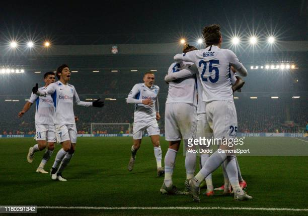Genk players celebrate after Mbwana Samatta levelled the score during the UEFA Champions League group E match between Liverpool FC and KRC Genk at...