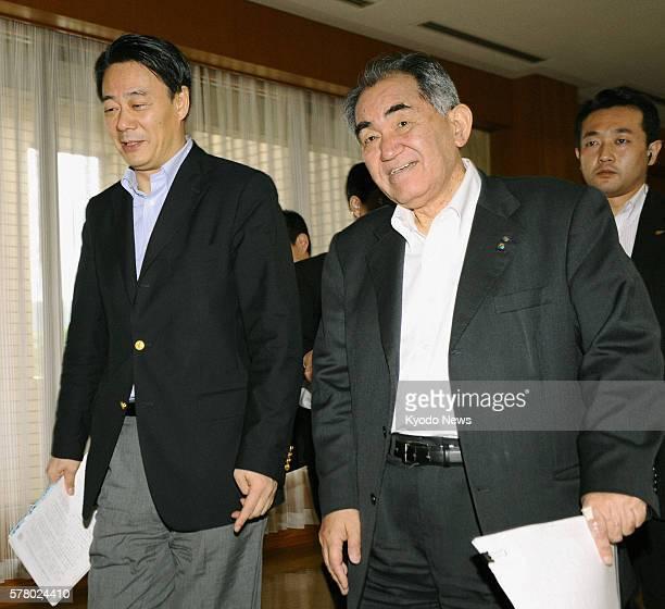 Genkai Japan Japanese Economy Trade and Industry Minister Banri Kaieda and Mayor Hideo Kishimoto of Genkai Saga Prefecture emerge from a meeting in...