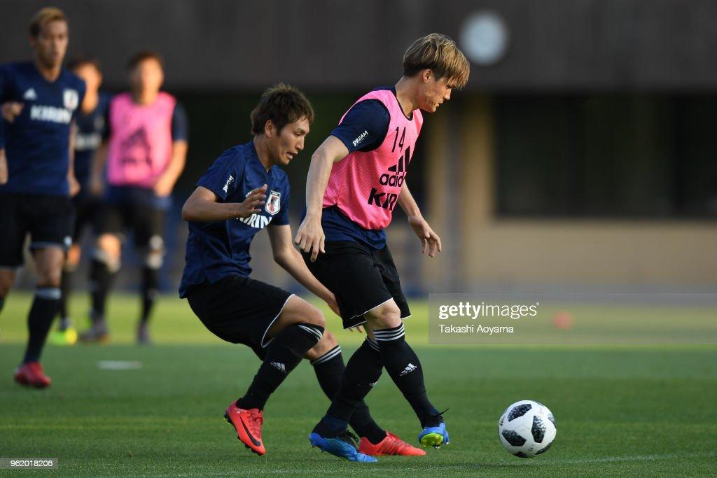 Genki Haraguchi (L) and Gotoku Sakai compete for the ball during a Japan training session at Akitsu Football Field on May 24, 2018 in Narashino, Chiba, Japan.