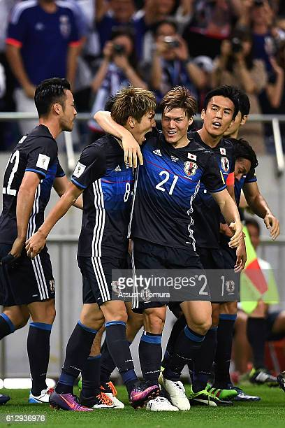 Genki Haraguchi and Gotoku Sakai of Japan celebrate after making their first goal during the 2018 FIFA World Cup Qualifiers match between Japan and...