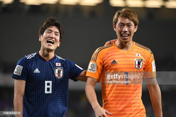 Genki Haraguchi and Masaaki Higashiguchi of Japan celebrate for reaching the final during the AFC Asian Cup semi final match between Iran and Japan...