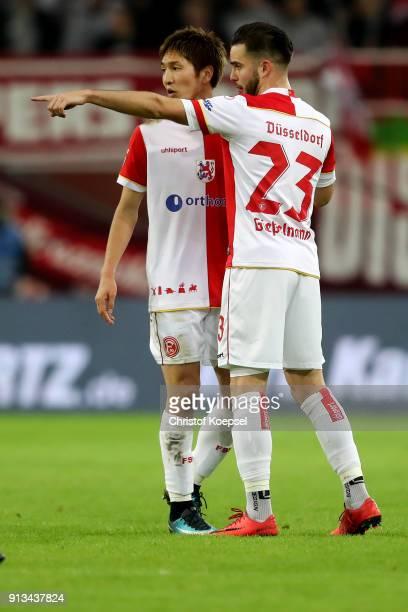 Genki Haraguchi and Niko Giesselmann of Duesseldorf speak during the Second Bundesliga match between Fortuna Duesseldorf and SV Sandhausen at...