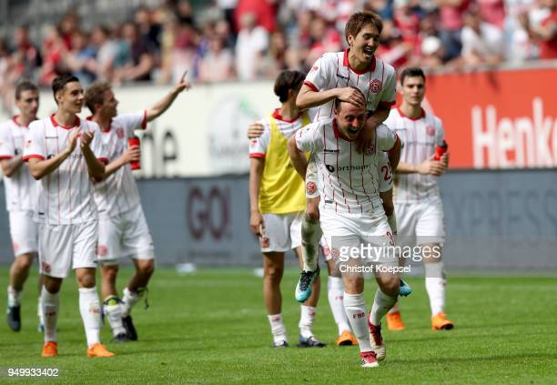 Genki Haraguchi and Robin Bormuth of Duesseldorf celebrate after the Second Bundesliga match between Fortuna Duesseldorf and FC Ingolstadt 04 at...