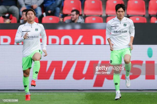 Genki Haraguchi and Takuma Asano of Hannover warm up prior to the Bundesliga match between Bayer 04 Leverkusen and Hannover 96 at BayArena on October...