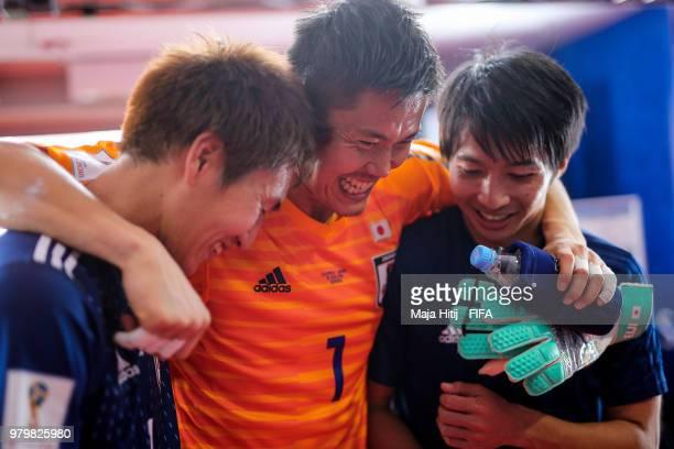 Genki Haraguchi Eiji Kawashima and Gaku Shibasaki of Japan hug after the 2018 FIFA World Cup Russia group H match between Colombia and Japan at...