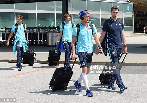 Genki Haraguchi Hajime Hosogai Fabian Lustenberger and Michael Becker of Hertha BSC during their arrival at Salzburg Airport ahead of the training...