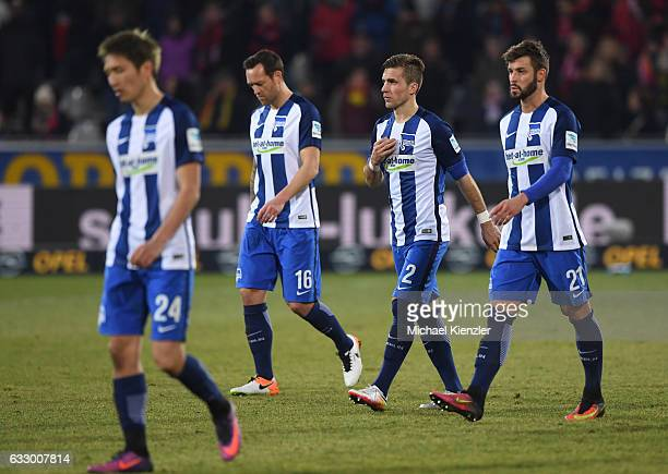 Genki Haraguchi Julian Schieber Peter Pekarik and Marvin Plattenhardt of Hertha BSC leave the pitch after the Bundesliga match between Sport Club...