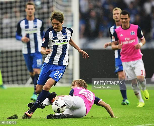 Genki Haraguchi of Berlin is challenged by Alen Halilovic of Hamburg during the Bundesliga match between Hertha BSC and Hamburger SV at...