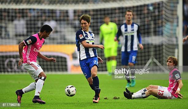 Genki Haraguchi of Berlin is challenged by Alen Halilovic of Hamburg during the Bundesliga match between Hertha BSC and Hamburger SV at...