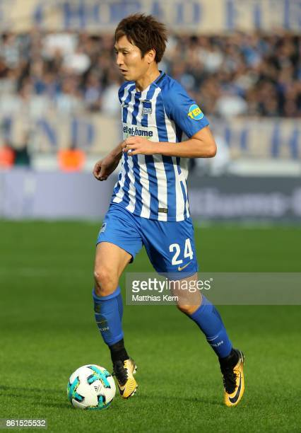 Genki Haraguchi of Berlin runs with the ball during the Bundesliga match between Hertha BSC and FC Schalke 04 at Olympiastadion on October 14 2017 in...
