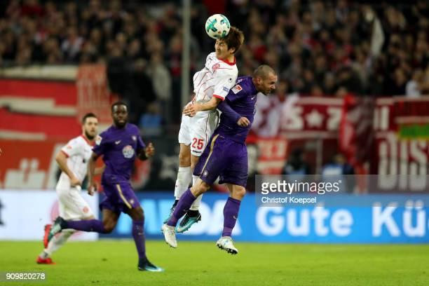 Genki Haraguchi of Duesseldorf and Christian Tiffert of Erzgebirge Aue go up for a header during the Second Bundesliga match between Fortuna...