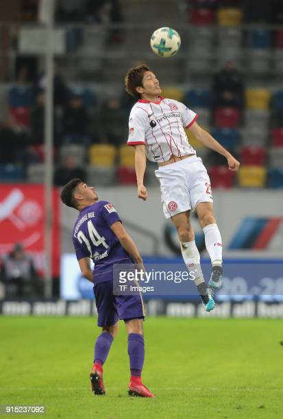Genki Haraguchi of Duesseldorf and JohnPatrick Strauss of Aue battle for the ball during the Second Bundesliga match between Fortuna Duesseldorf and...