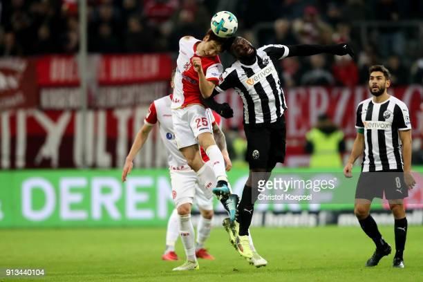 Genki Haraguchi of Duesseldorf and Richard SukutaPasu of Sandhausen go up for a header during the Second Bundesliga match between Fortuna Duesseldorf...