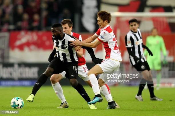 Genki Haraguchi of Duesseldorf challenges Richard SukutaPasu of Sandhausen during the Second Bundesliga match between Fortuna Duesseldorf and SV...