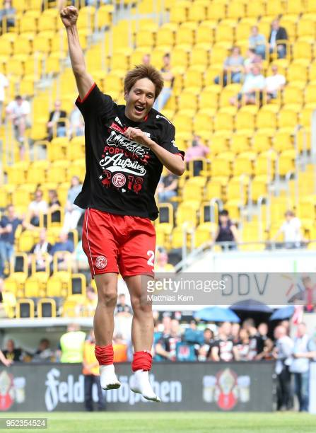 Genki Haraguchi of Duesseldorf jubilates after moving up into the Bundesliga after the Second Bundesliga match between SG Dynamo Dresden and Fortuna...