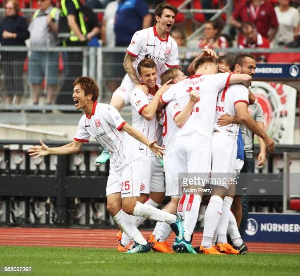 Genki Haraguchi of Fortuna Duesseldorf celebrates victory in the match and winning the Bundesliga 2 championship during the Second Bundesliga match...
