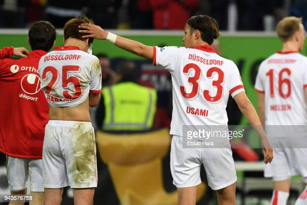 Genki Haraguchi of Fortuna Duesseldorf is consoled by Takashi Usami after the Second Bundesliga match between Fortuna Duesseldorf and VfL Bochum 1848...