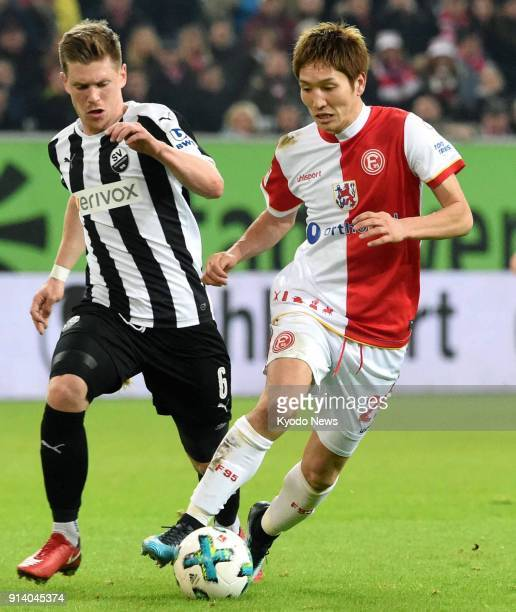 Genki Haraguchi of Fortuna Dusseldorf vies with Denis Linsmayer of Sandhausen in the first half of a 10 win home in a German seconddivision match in...