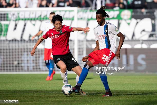 Genki Haraguchi of Hannover 96 and Gideon Jung of Hamburger SV battle for the ball during the Second Bundesliga match between Hannover 96 and...