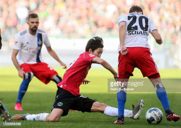 Genki Haraguchi of Hannover 96 fights for the ball with Louis Schaub of Hamburger SV during the Second Bundesliga match between Hannover 96 and...