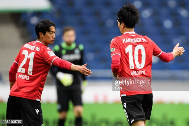 Genki Haraguchi of Hannover celebrates with teammate Sei Muroya after scoring his team's first goal during the Second Bundesliga match between...